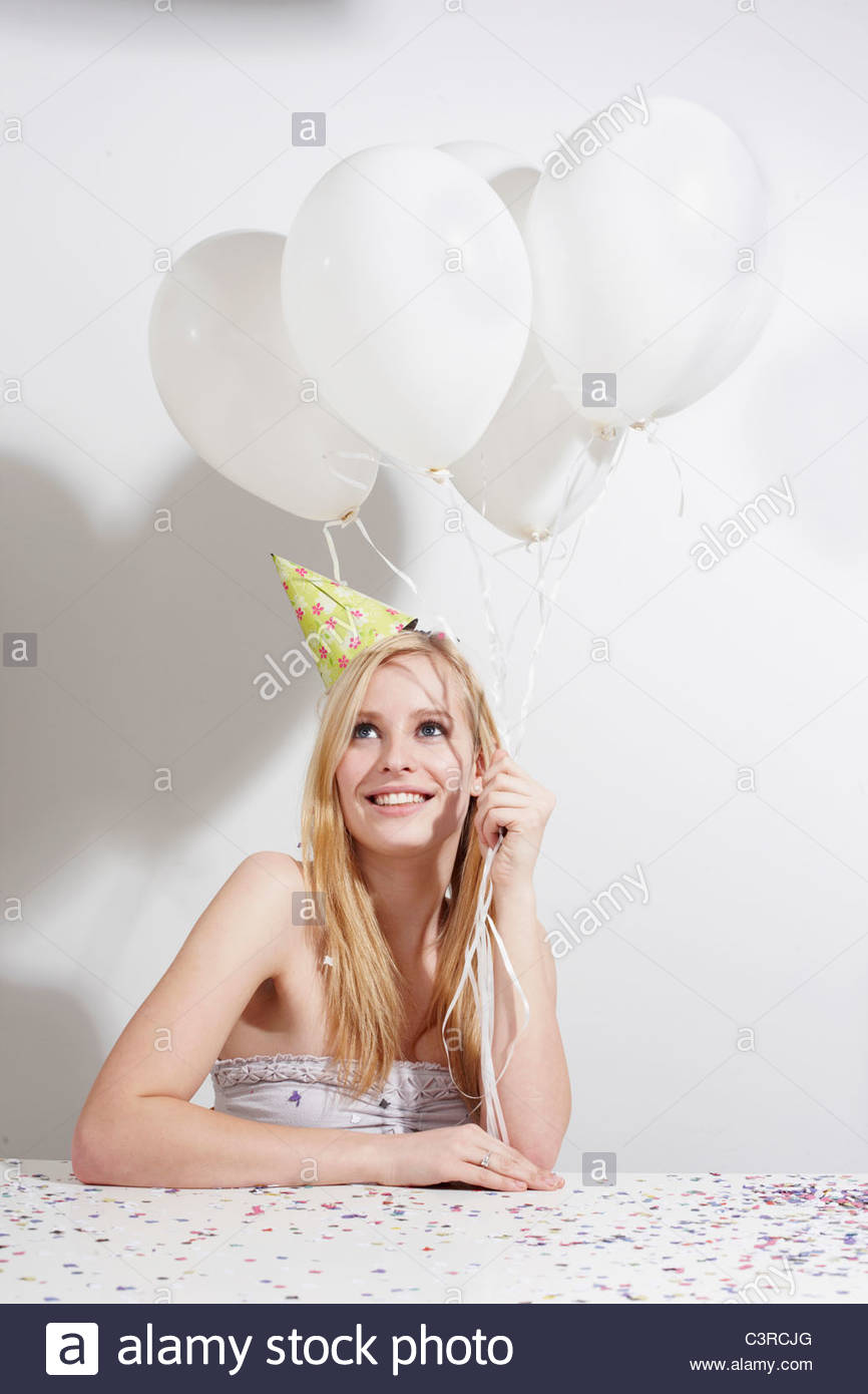 Woman with funny hat and confetti - Stock Image