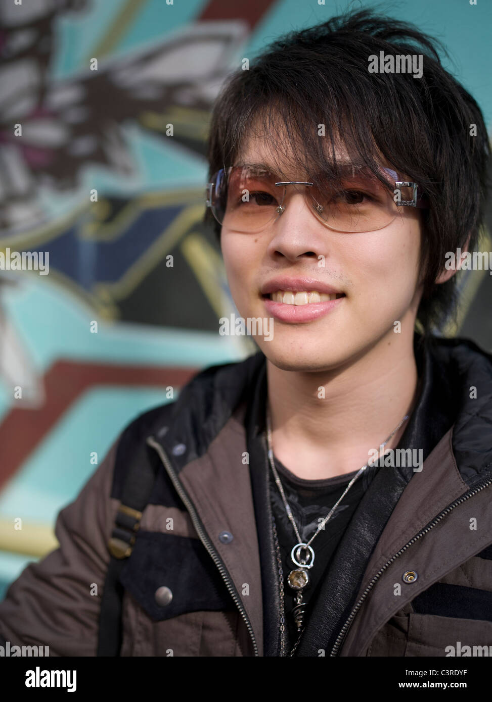 Young Japanese man in Amerika-mura, Osaka, Japan - Stock Image