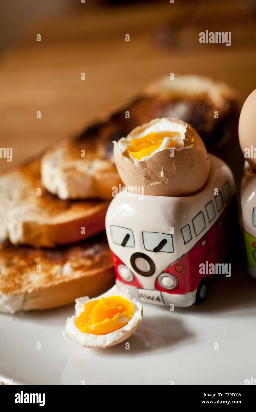 Breakfast - two boiled eggs in VW Camper van egg cups with toast - Stock Image