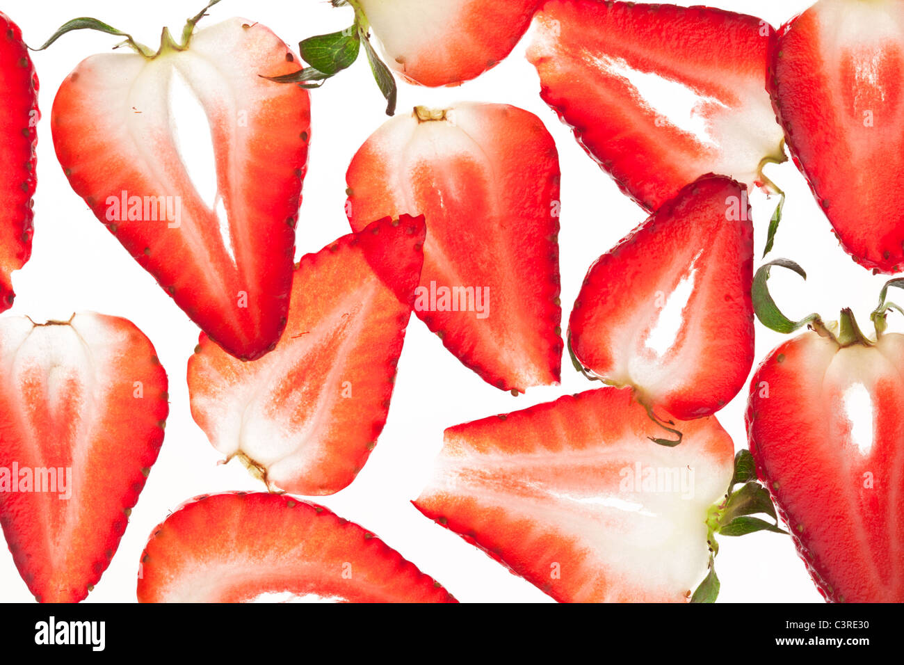 Back projected appetizing strawberry slices. - Stock Image