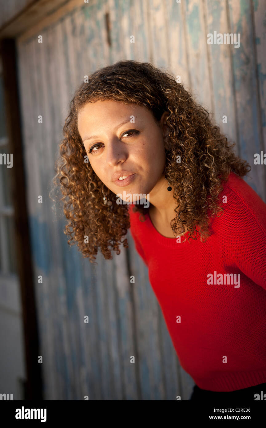 a 20 year old woman wearing red jumper - Stock Image