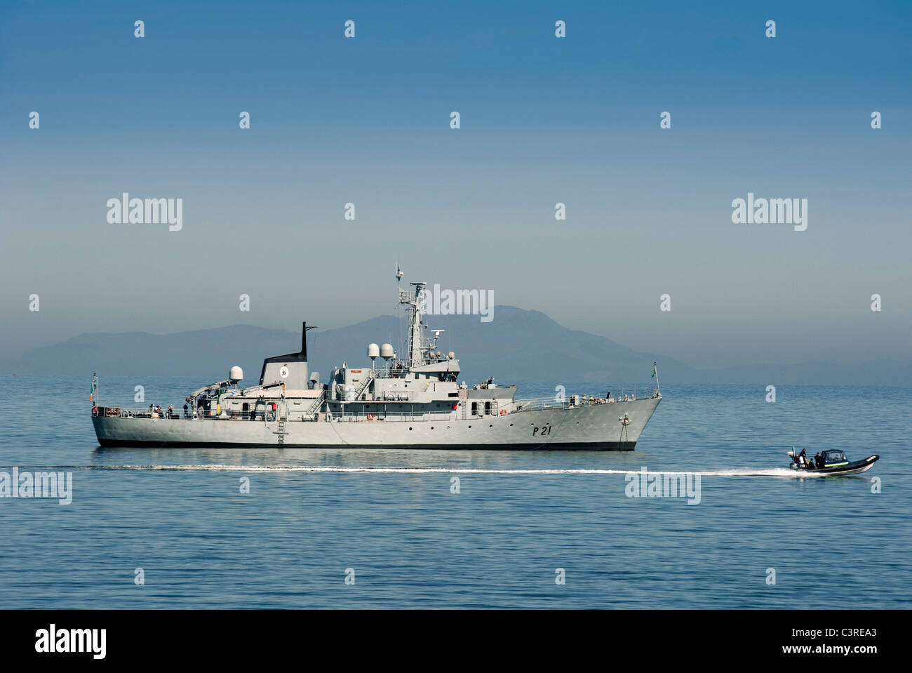 The LE Emer of the Irish Navy off the coast osf Skerries, county Dublin, Ireland with the Mountains of Mourne in - Stock Image