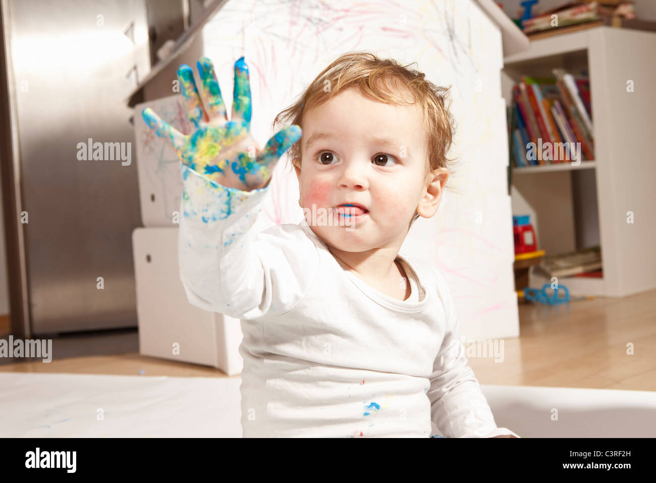 Boys hand covered with finger paint Stock Photo