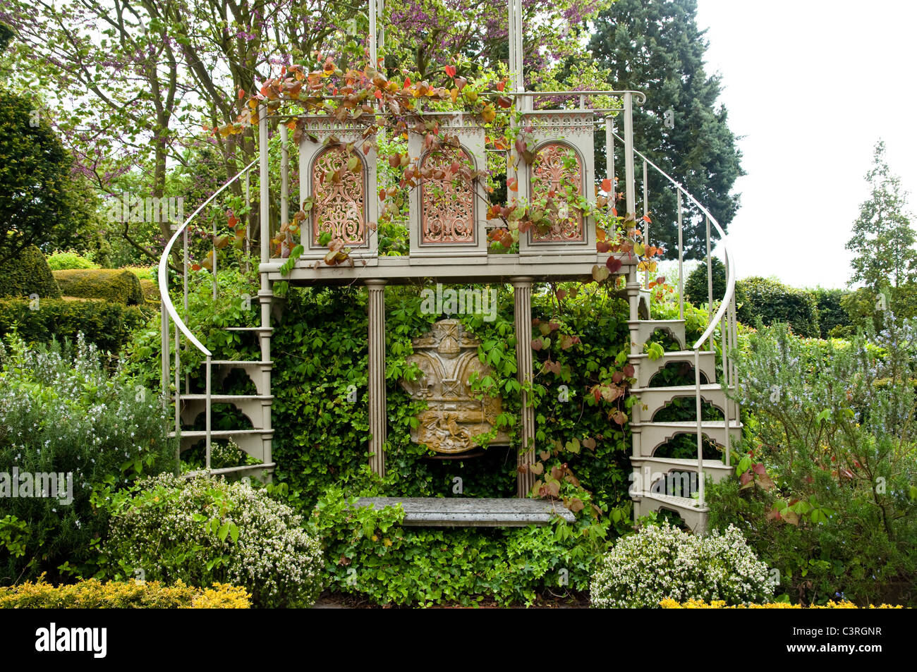 A pair of decorative spiral staircases leading up to a viewing platform.  The Laskett Gardens, Herefordshire, UK - Stock Image