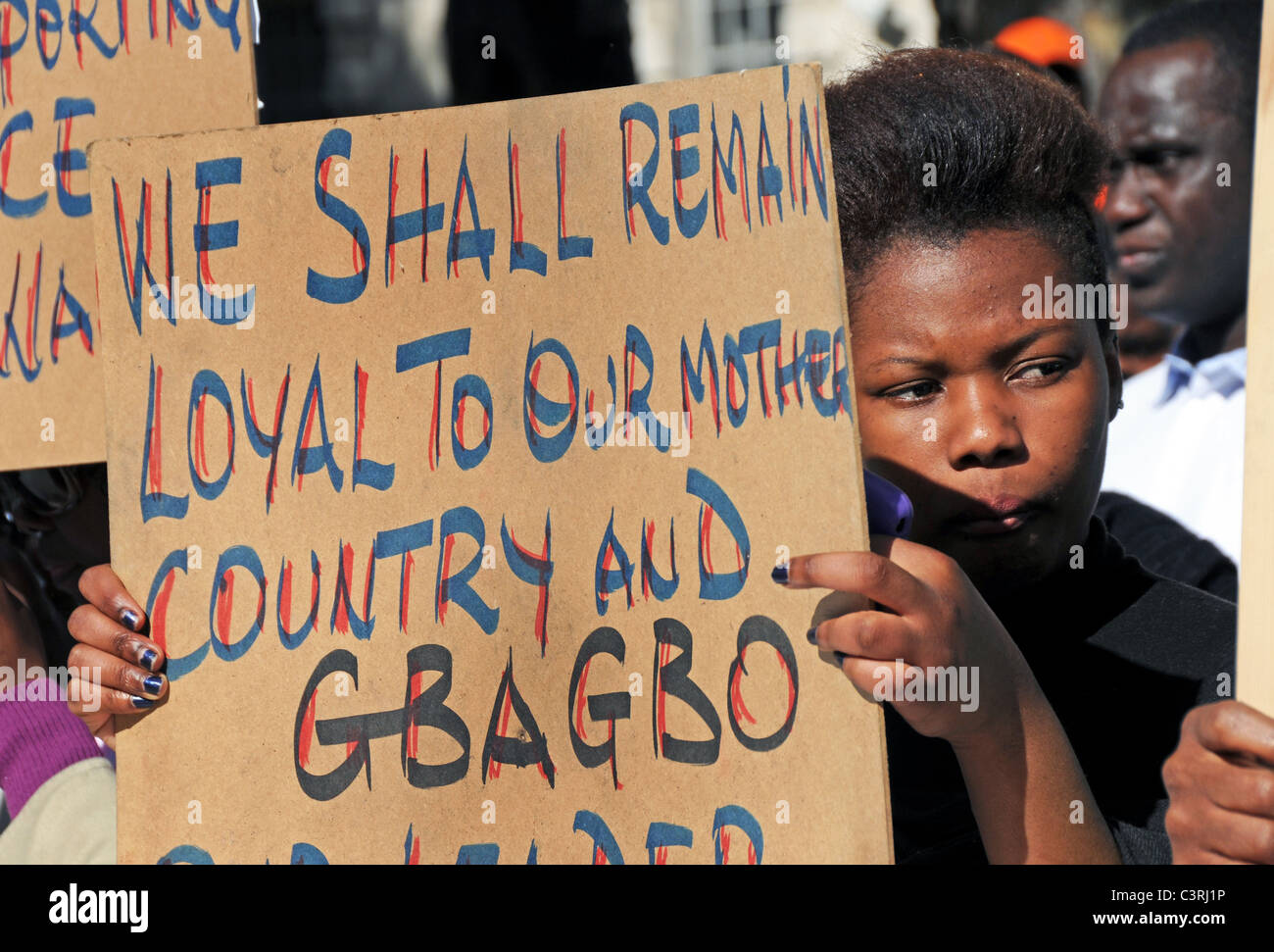 pro President Gbagbo supporters protest French & UN interference, rigging election & creating civil war - Stock Image