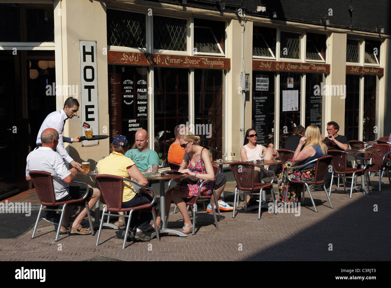 PEOPLE SAT AT CORNER HOUSE HOTEL CAFE AMSTERDAM HOLLAND 24 April 2011 - Stock Image