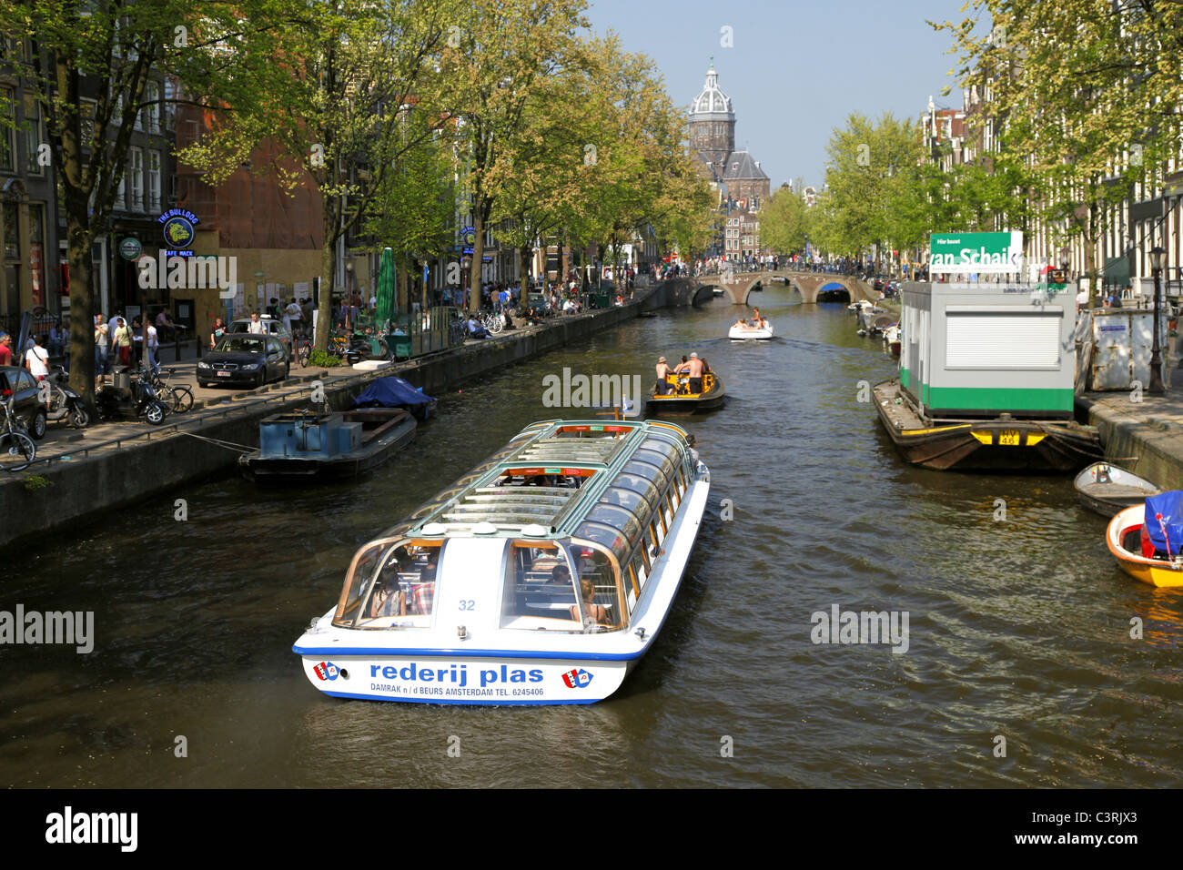 TOURIST BOAT & ST. NICHOLAS CATHEDRAL FROM LIESDELSLUIS BRIDGE AMSTERDAM 24 April 2011 - Stock Image