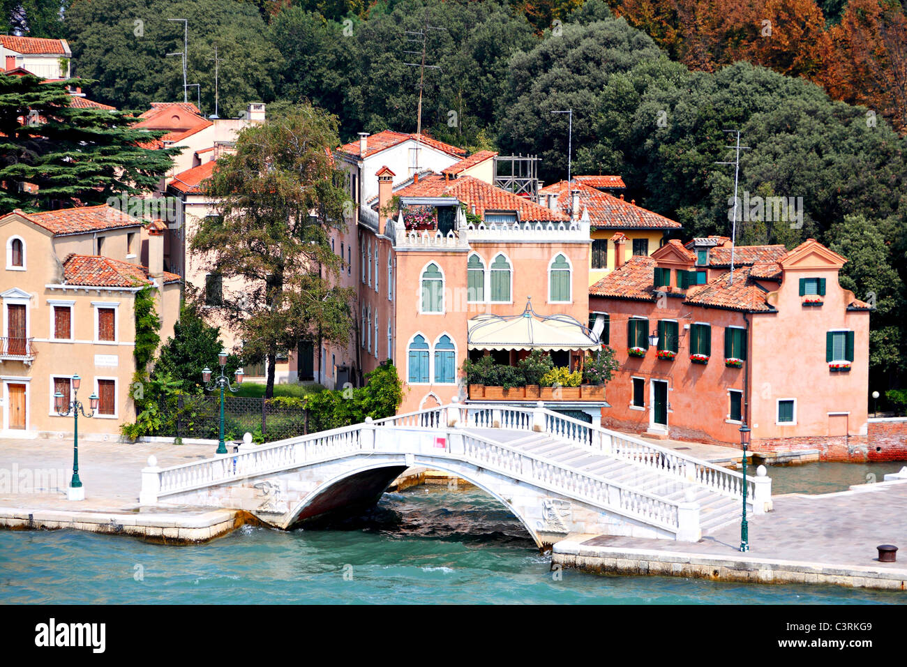 nice historic, white bridge with old houses in famous Venice - Stock Image