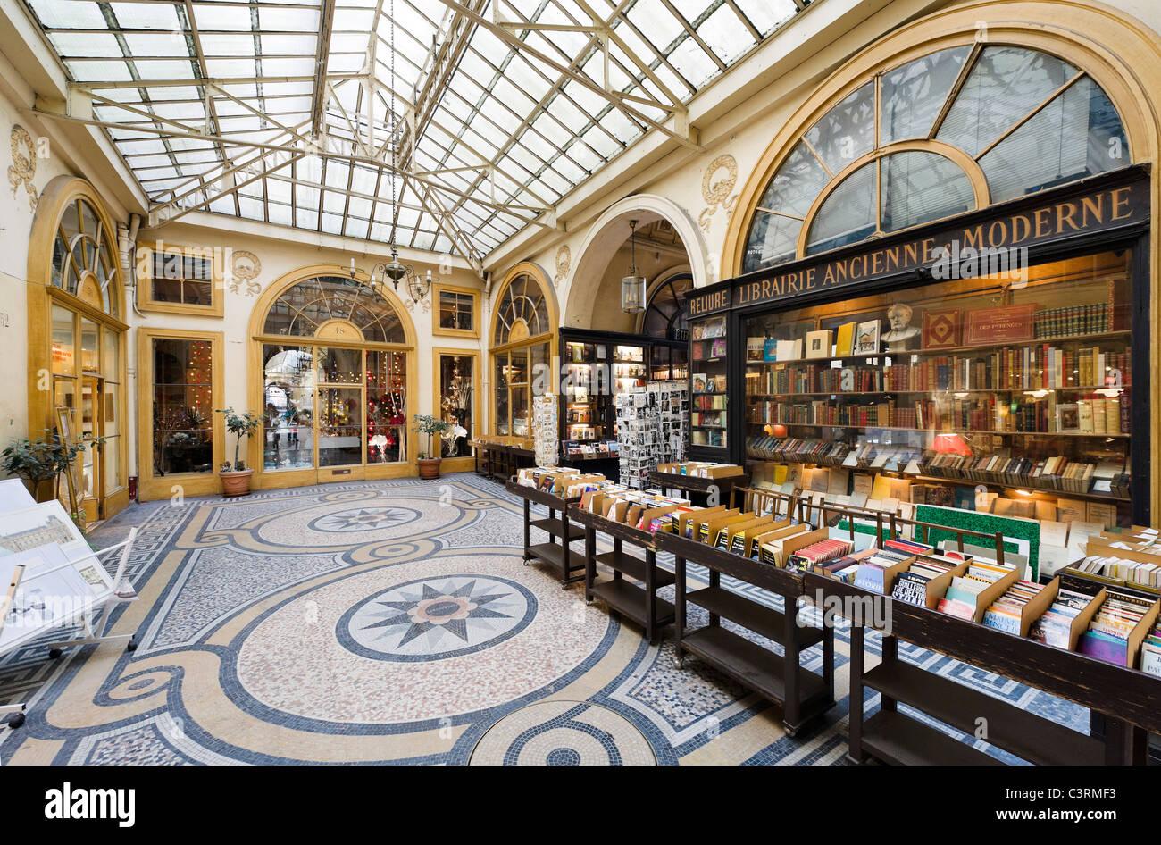 Secondhand bookshop in the Galerie Vivienne in the 2nd Arrondissement, Paris, France - Stock Image