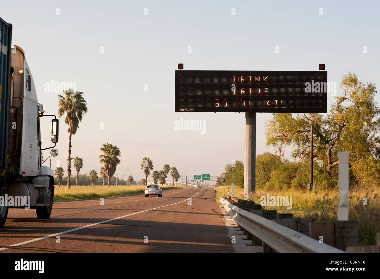 Highway message board on stretch of US Highway 77 in South Texas warns drivers against drunk driving - Stock Image