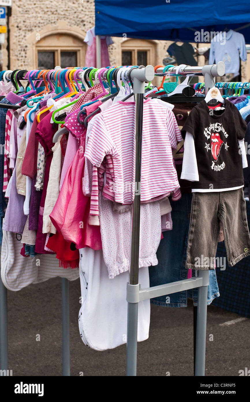 Children's clothing for sale at a market stall in Bury St Edmunds - Stock Image