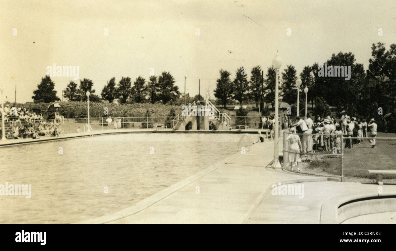 public swimming pool with diving board 1930s American swim - Stock Image