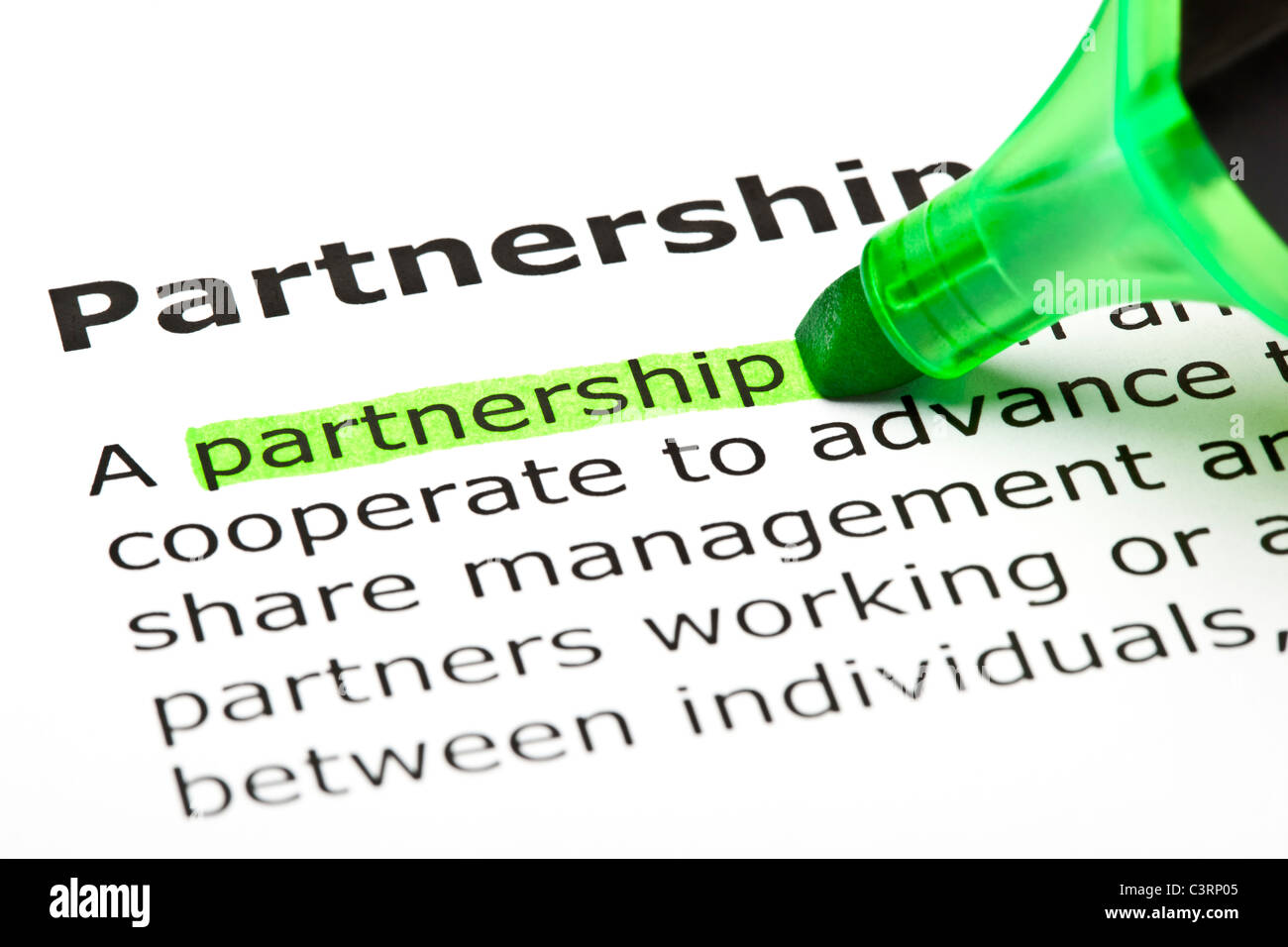 The word 'Partnership' highlighted in green with felt tip pen - Stock Image