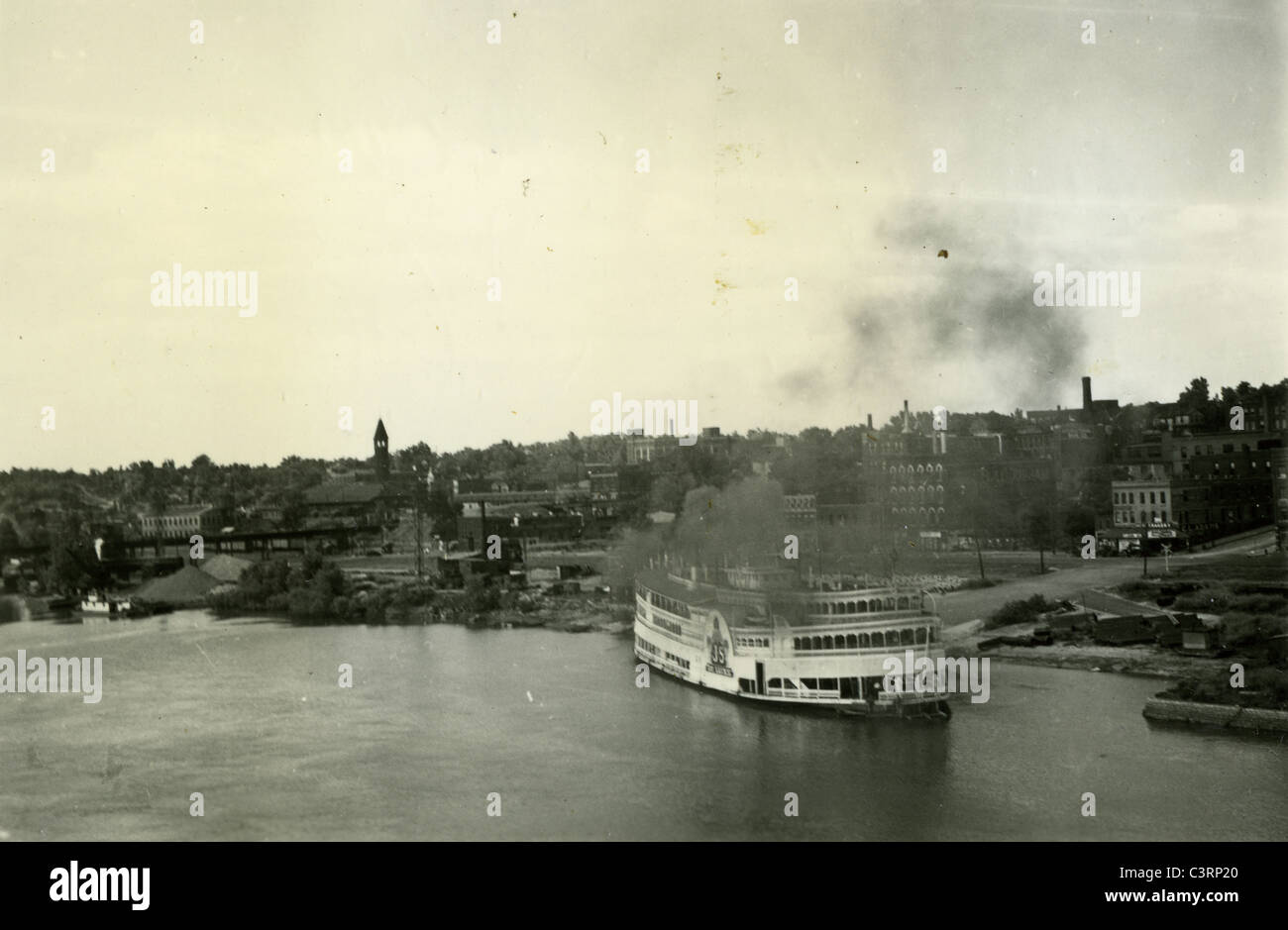 river boat docked in Quincy Illinois during the great depression 1939 1930s Americana travel - Stock Image