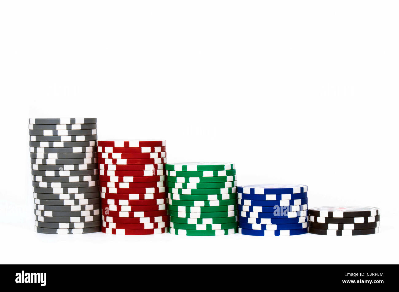 Piled poker chips in row isolated on white background - Stock Image