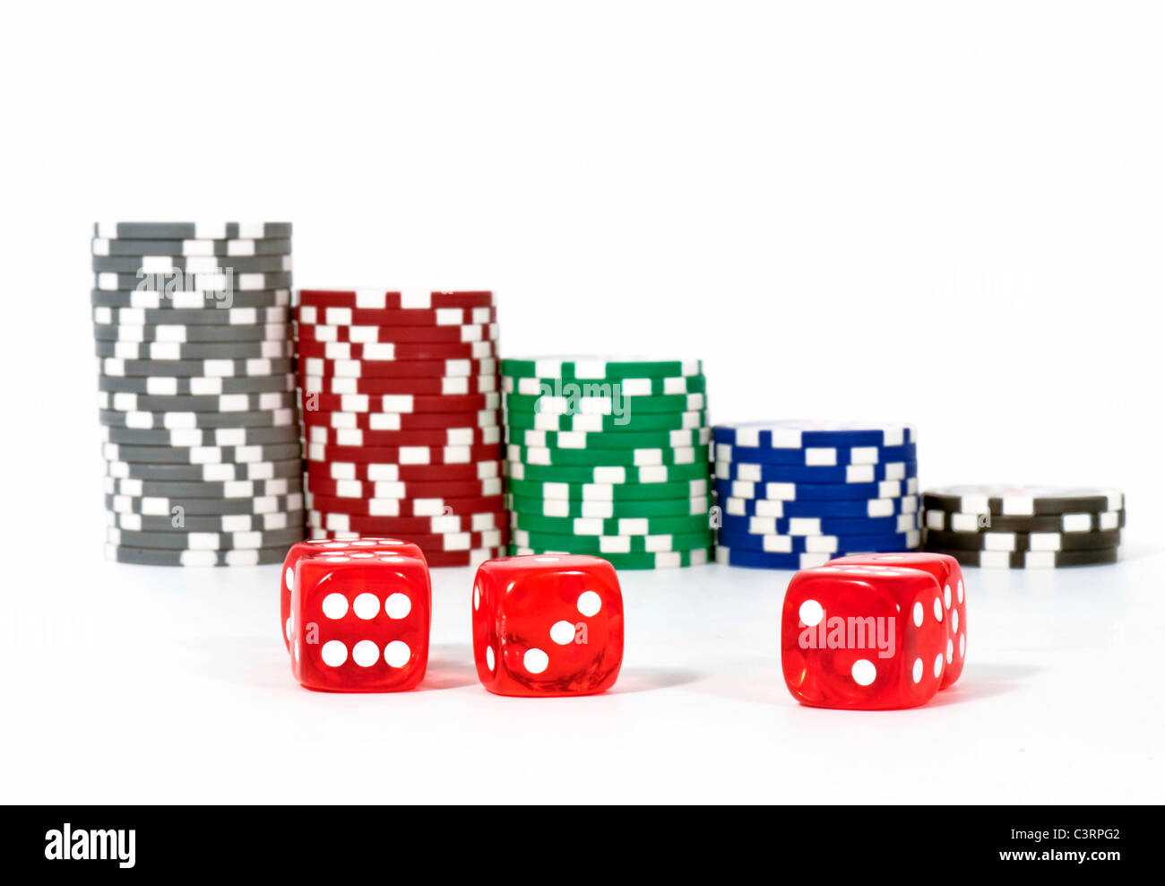 Dice with chips gabling, isolated on white background - Stock Image