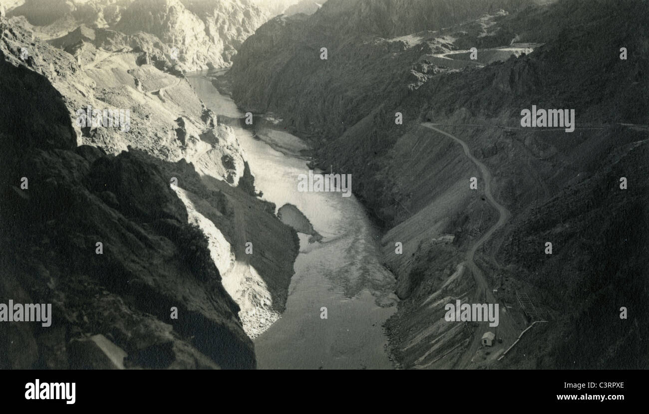 view looking upon river below boulder dam in 1940. southwest landscape mountains colorado river hoover dam - Stock Image