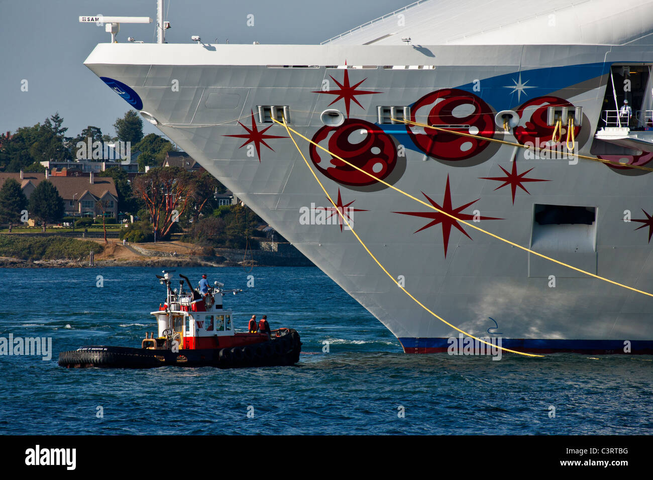 Tugboat and large cruise ship in port of Victoria-Victoria, British Columbia, Canada. - Stock Image