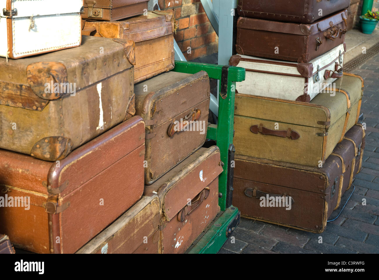Travel luggage on a railway platform - Stock Image