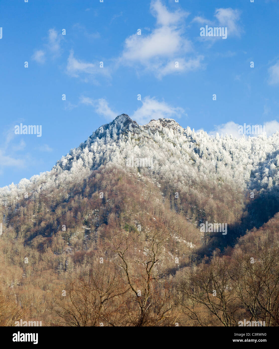 Famous Great Smoky Mountains National Park view of Chimney Tops covered in snow in early spring, USA - Stock Image