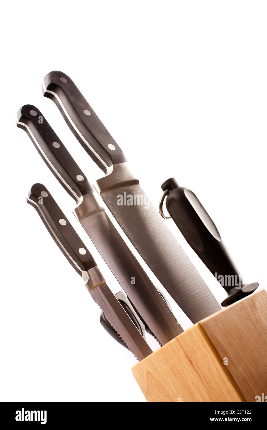 Closeup of a set of kitchen knives in a wooden rack, isolated on ...
