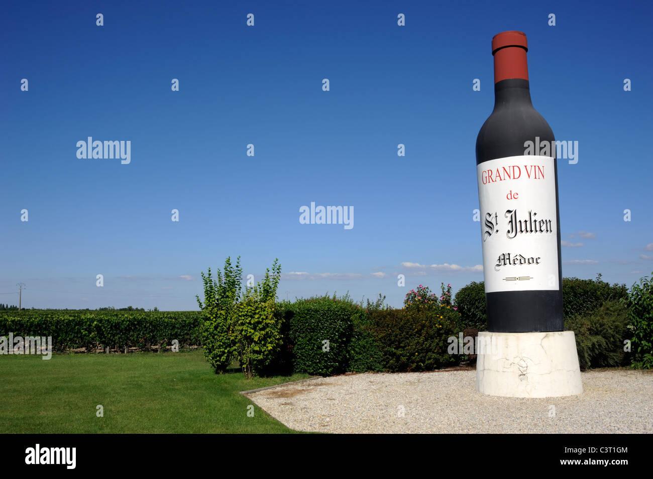 france, bordeaux, medoc vineyards, giant wine bottle - Stock Image