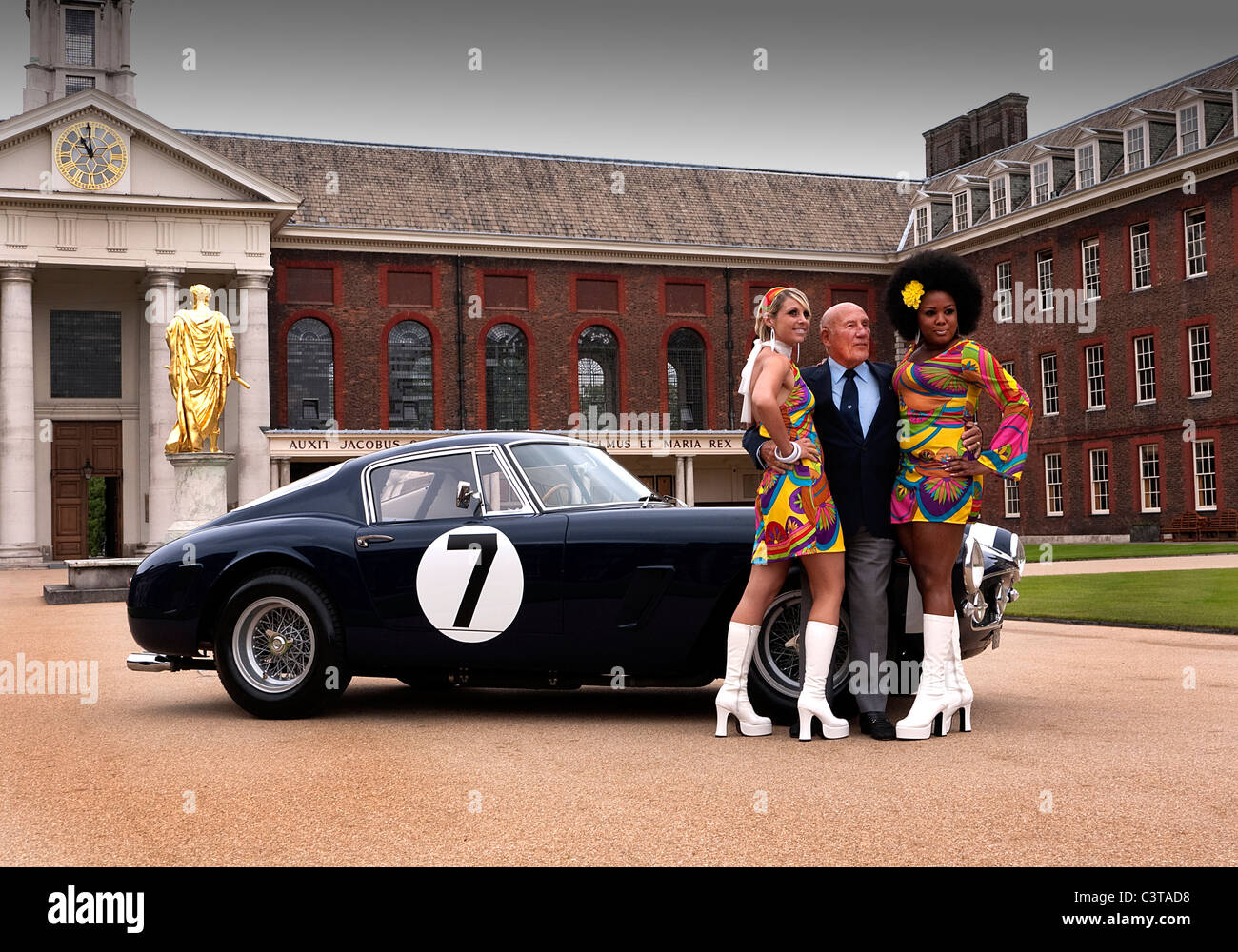 Sir Stirling Moss OBE with Swinging Sixties models and 1961 Ferrari 250GT SWB - Stock Image