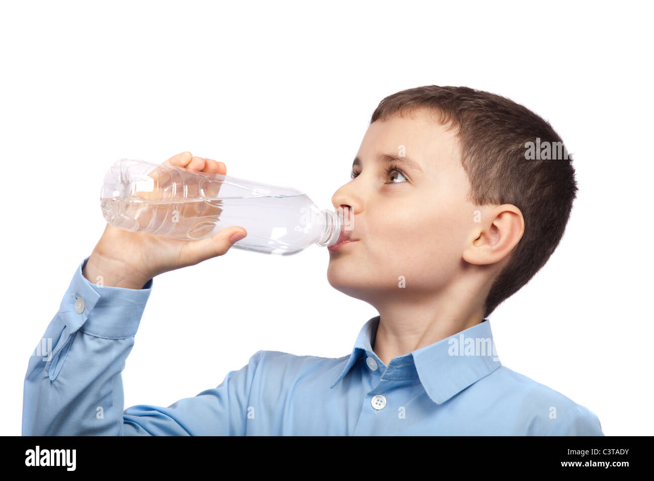 Closeup portrait of a boy drinking water, isolated on white background - Stock Image