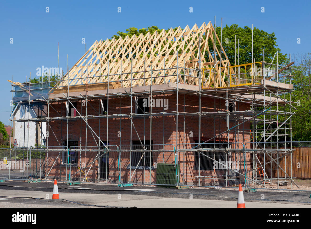 New housing under construction on residential estate on a former brown field site England GB UK EU Europe - Stock Image
