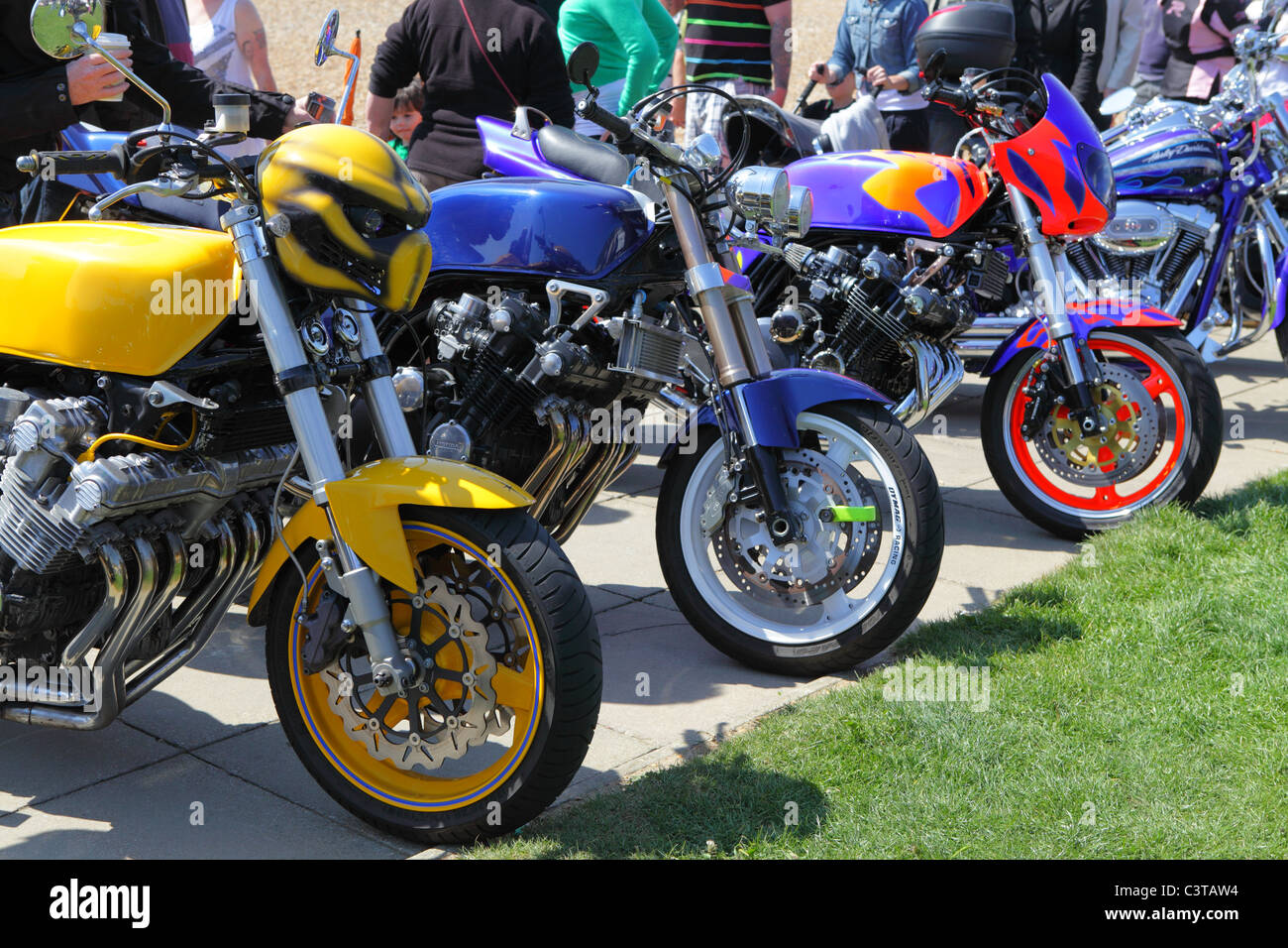 Colourful motorbikes on Hastings seafront at the annual May Day motorbike rally, East Sussex, England, UK, GB - Stock Image