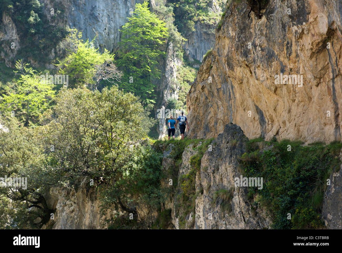 Walking the Cares Gorge footpath, Picos de Europa, Castilla y Leon, Spain - Stock Image