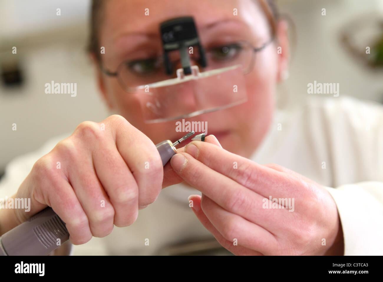 Work in a dental laboratory - Stock Image