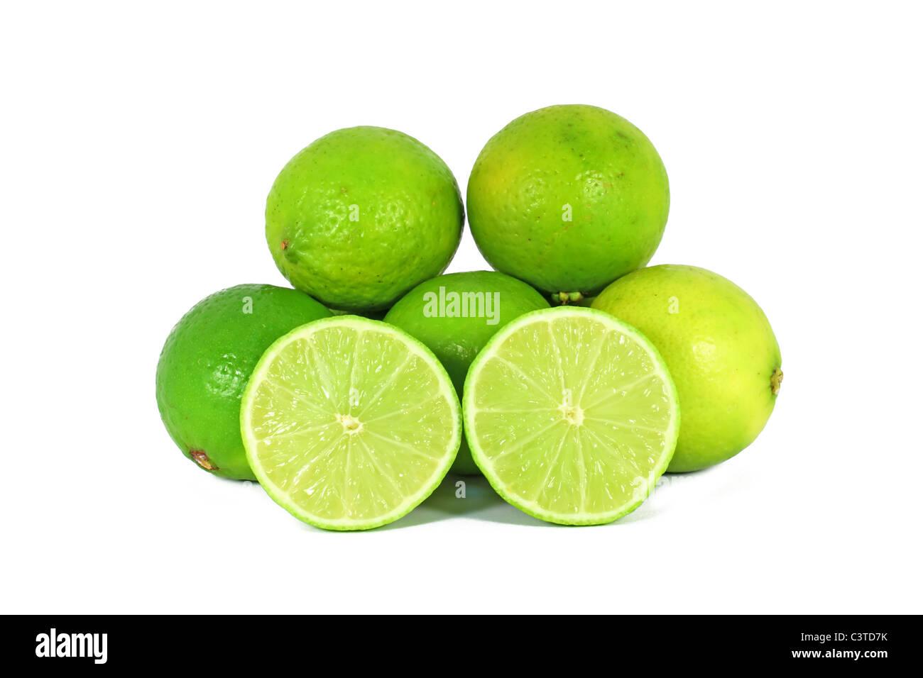 Limes, citrus fruit isolated on white background - Stock Image