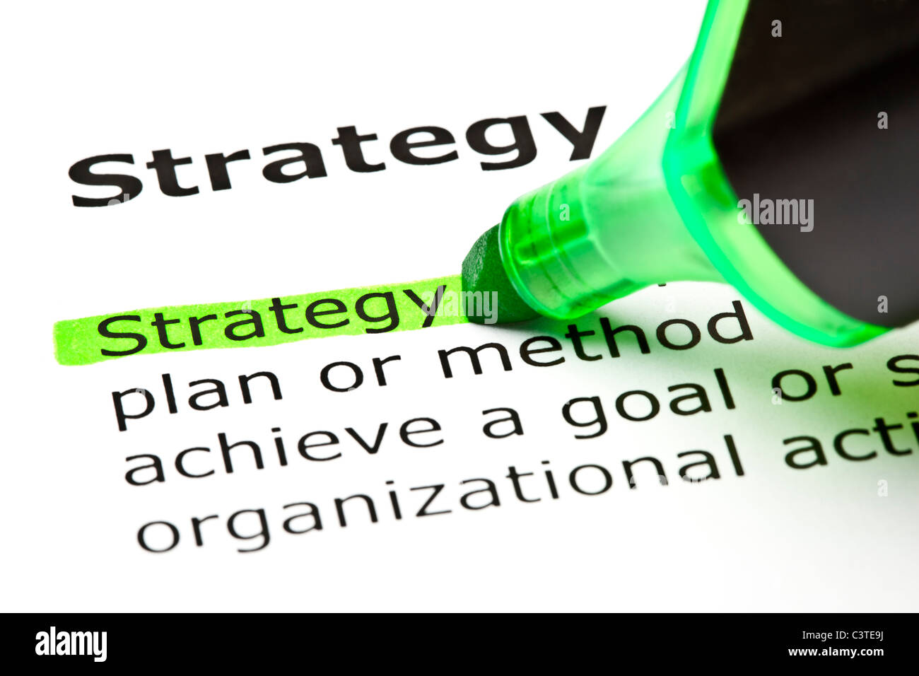 The word 'Strategy' highlighted in green with felt tip pen - Stock Image