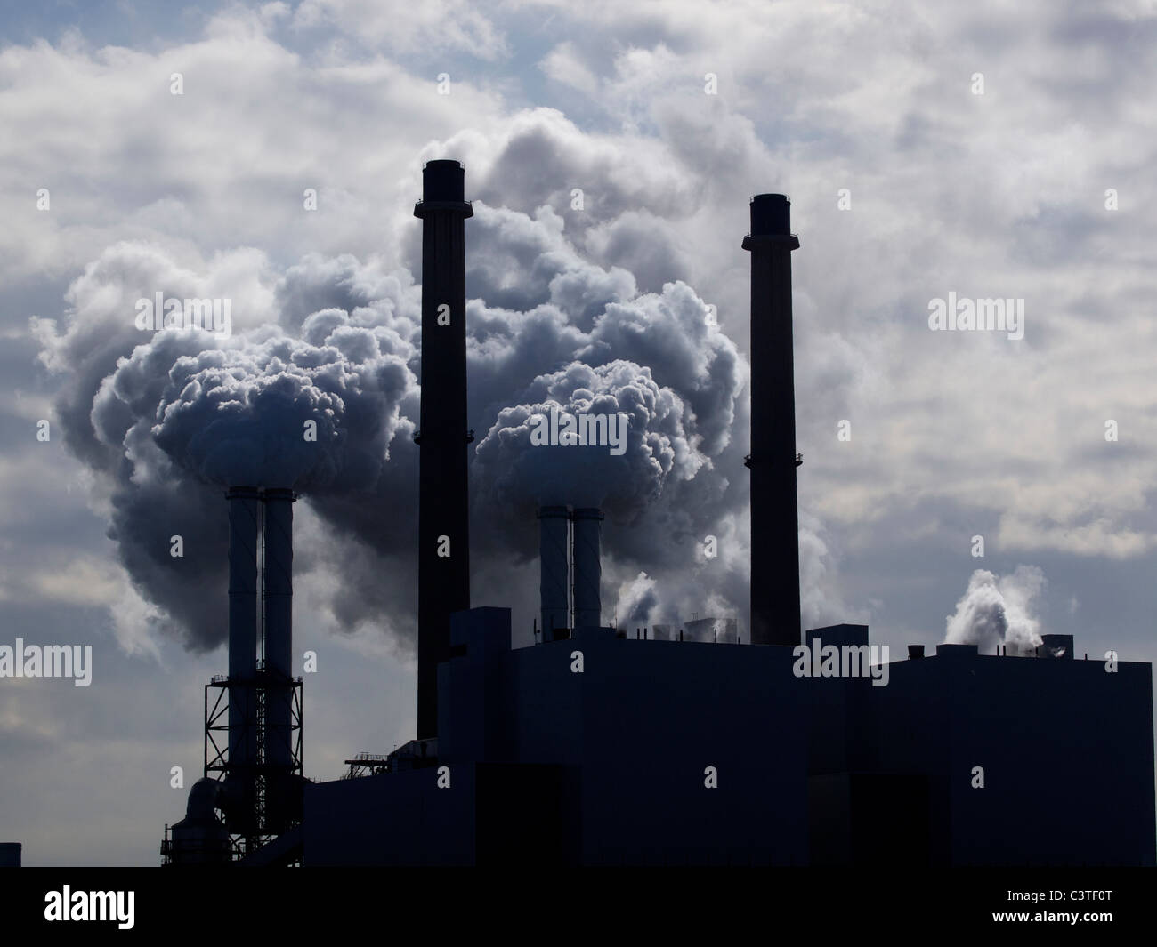 smoke stacks with lots of smoke, E-on powerplant Maasvlakte, Port of rotterdam, the Netherlands - Stock Image