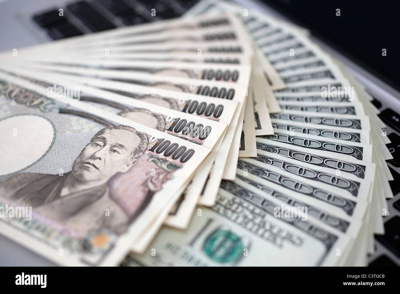 Computer keyboard and money - Stock Image