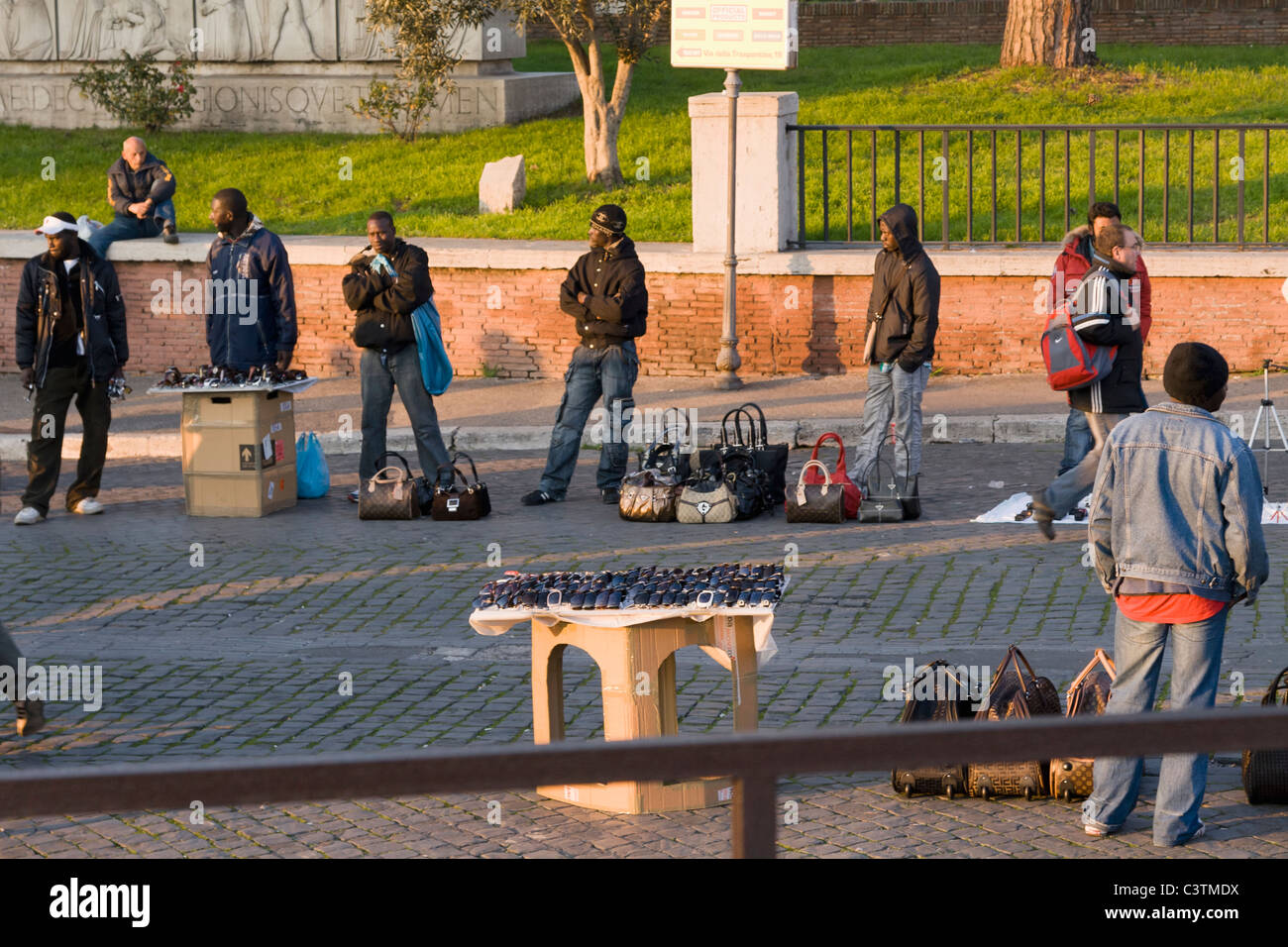 African immigrants set up illegal street stalls selling fake brand goods, Rome, Italy - Stock Image