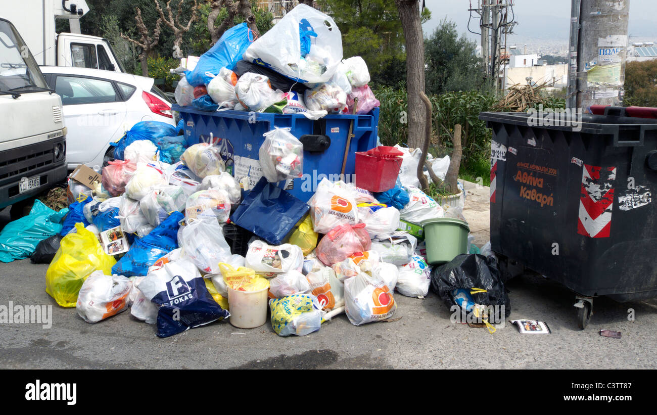 greece athens psychicho rubbish bins overflowing after the weekly market - Stock Image