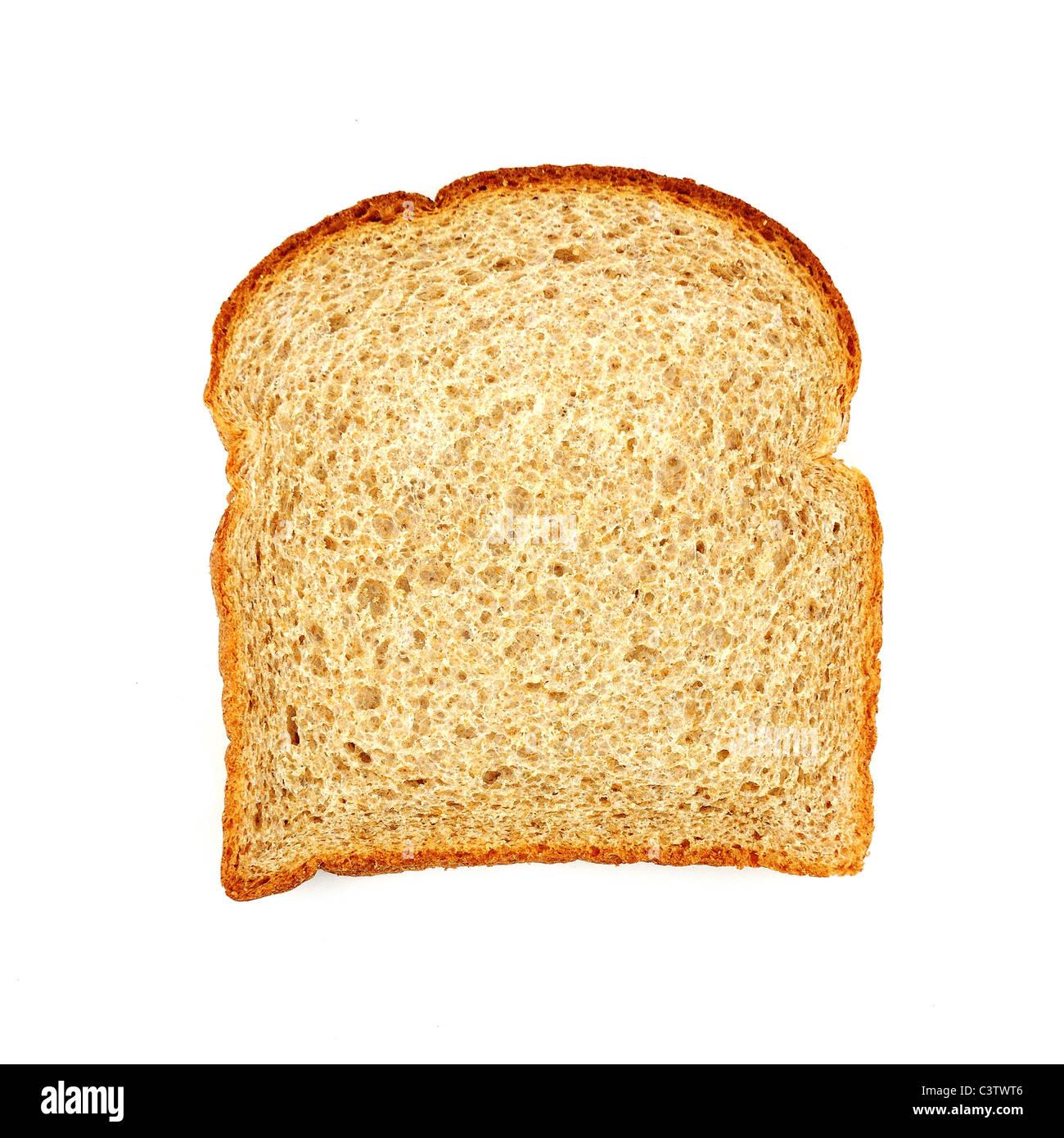 slice of whole wheat bread - Stock Image