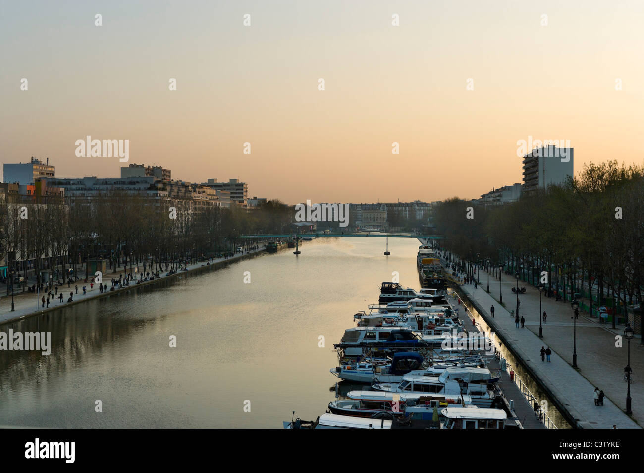 Sunset in the Bassin de la Villette viewed from a balcony in the Holiday Inn Express, Paris, France. - Stock Image