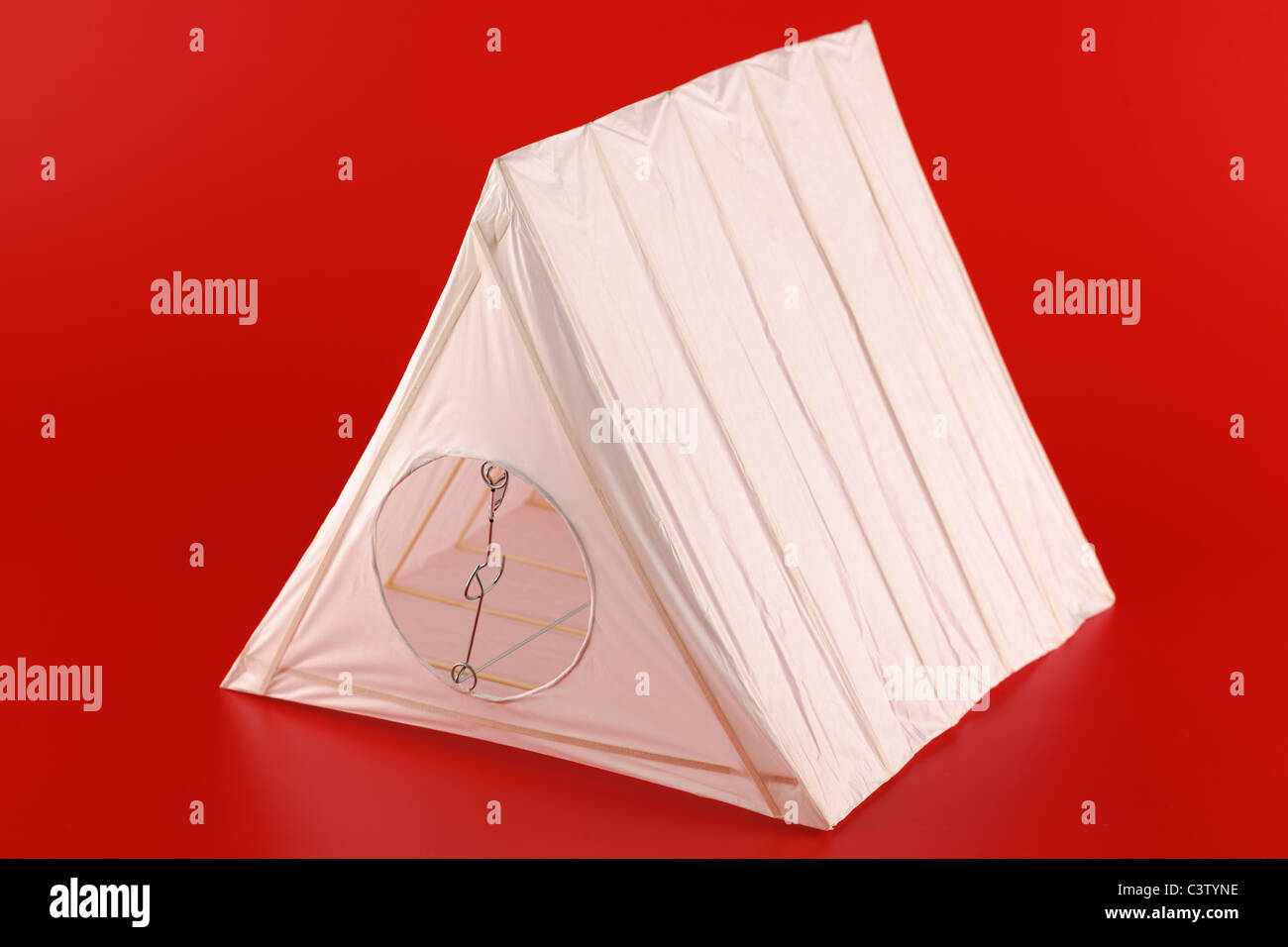 Triangular wire and paper lightshade - Stock Image