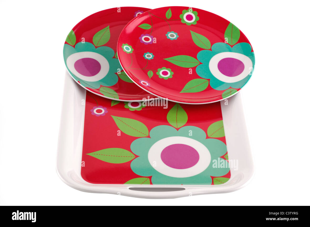 two abstract flower patterned circular plates and matching tea tray - Stock Image