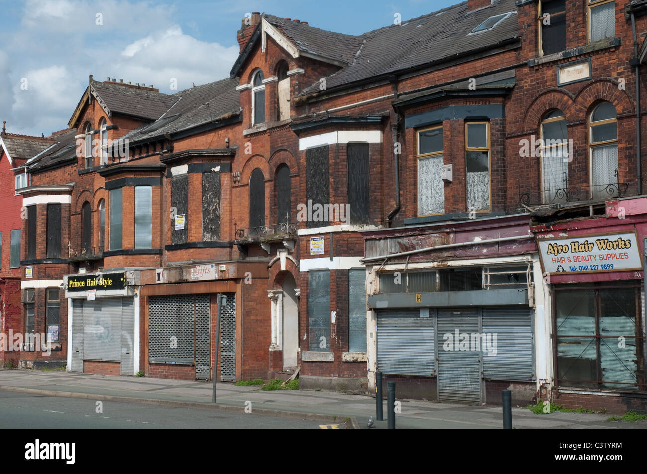 Row of terraced shops Princess Road,Moss Side,Manchester. - Stock Image