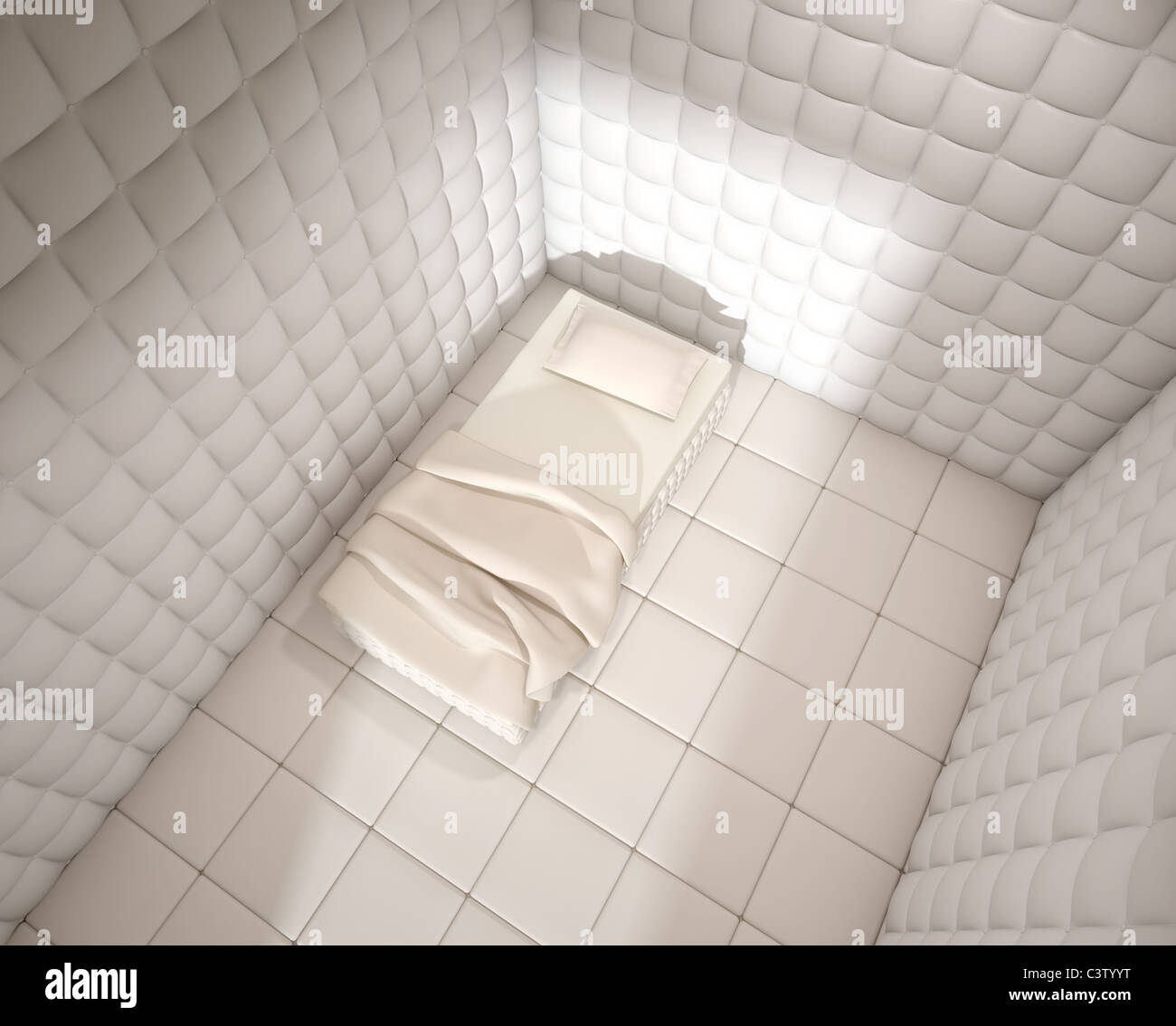 mental hospital padded room seen from above with a single bed Stock Photo