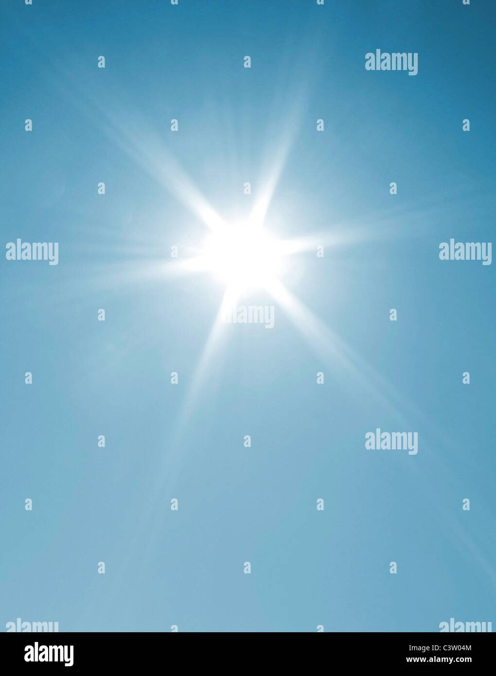 The sun shining on a coudless day - Stock Image