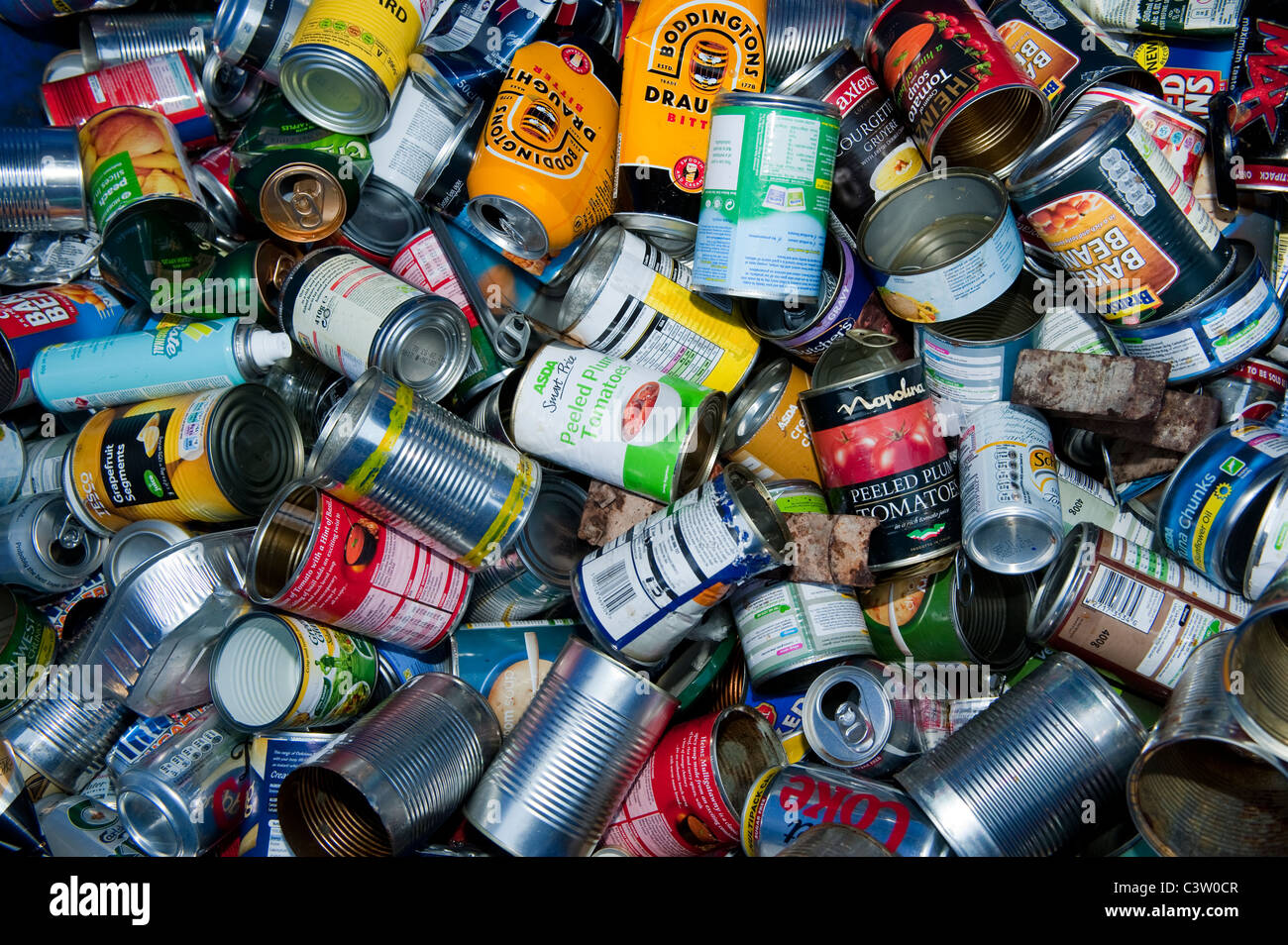 Aluminum cans in recycling bin. - Stock Image