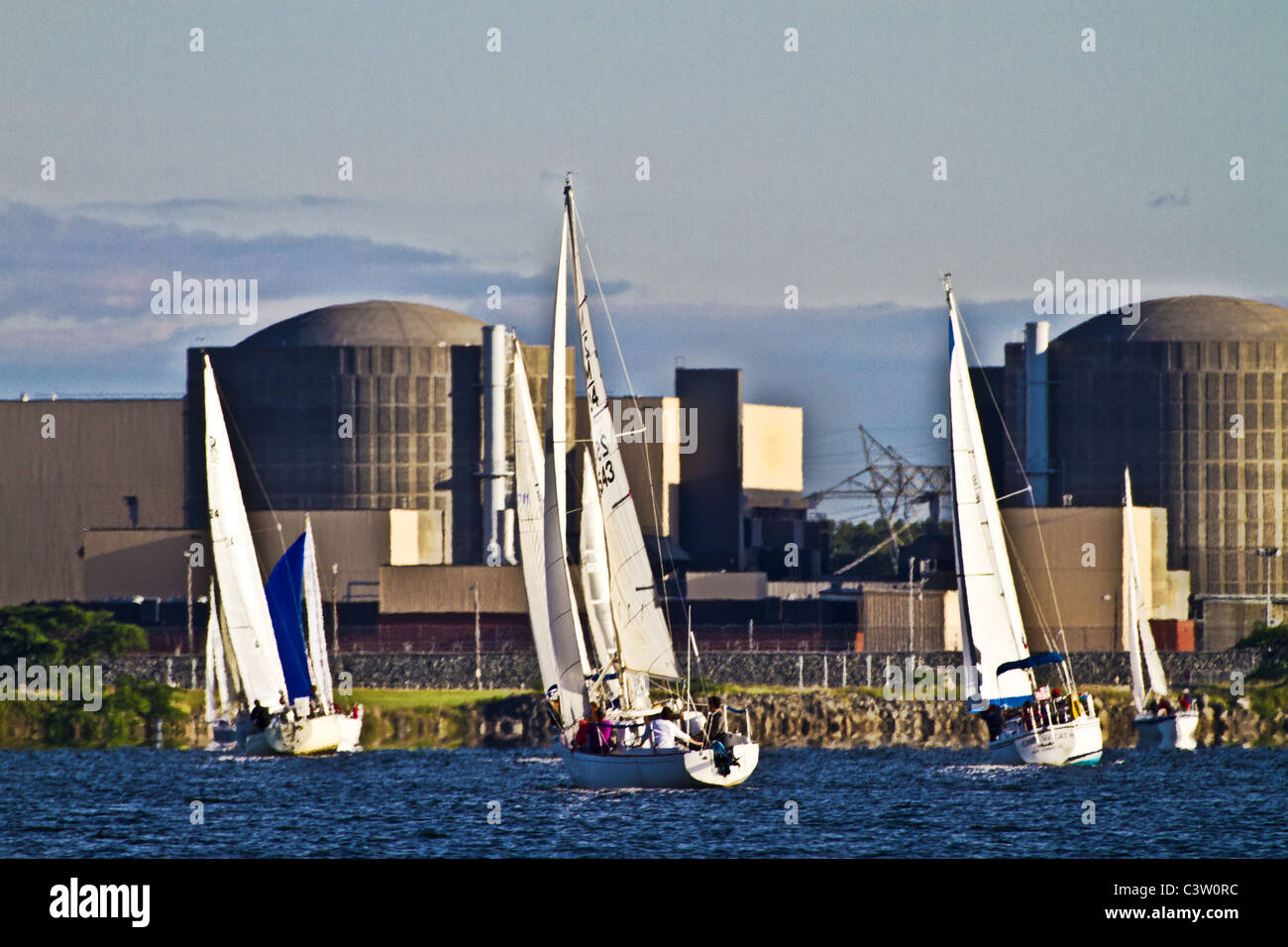 Sail Boats Racing in front of nuclear power station - Stock Image