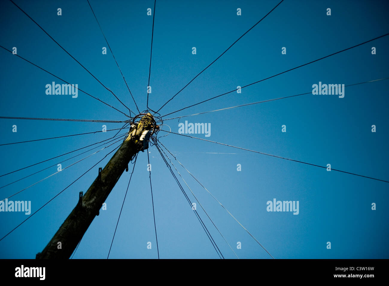 A mast for landline telephone wire connection. - Stock Image