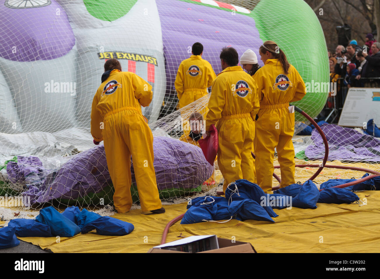 Macy's employees inflating the Buzz Lightyear balloon for the 2010 Macy's Thanksgiving Day parade in New - Stock Image