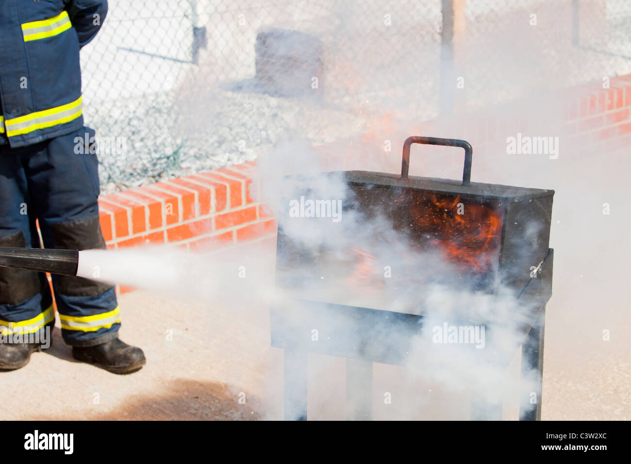 A fire fighting exercise. - Stock Image